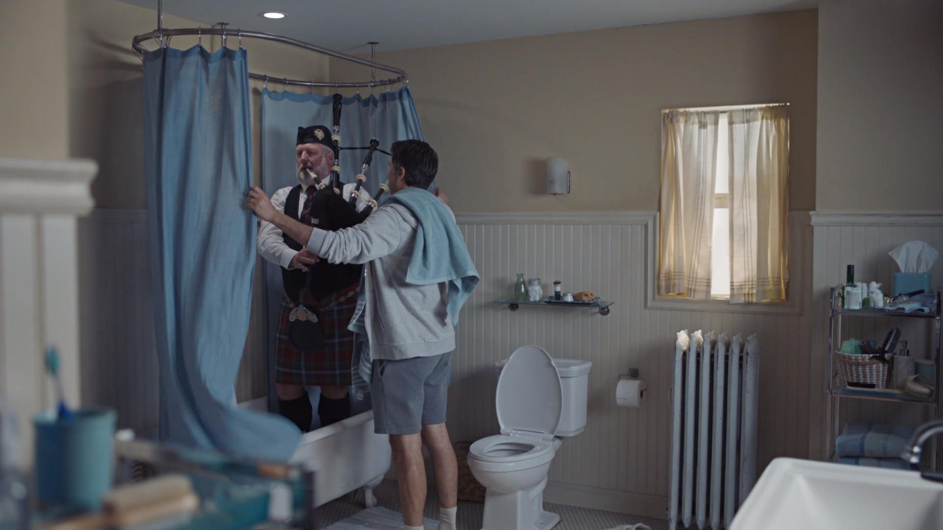 wall indoor bathroom person sink mirror vase plumbing fixture