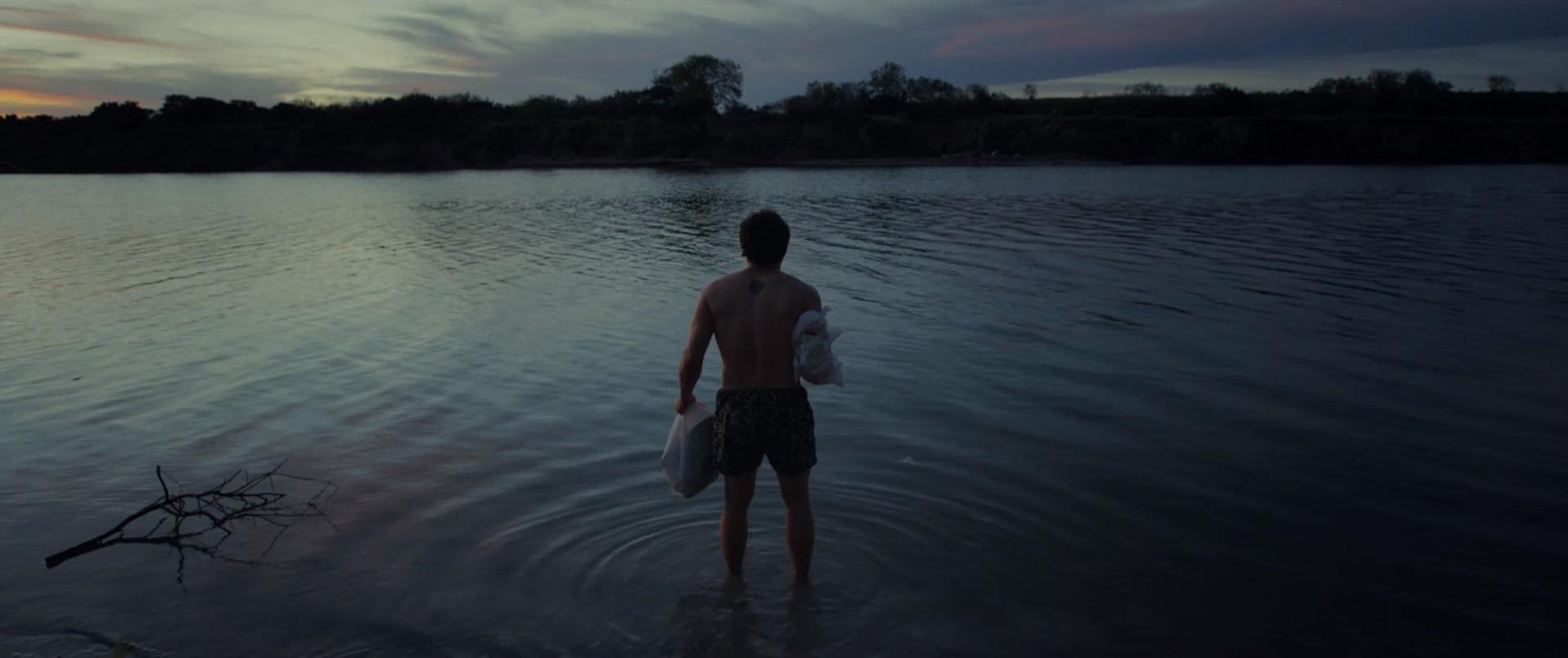 water outdoor lake man person beach sky clothing swimming nature river dark shore