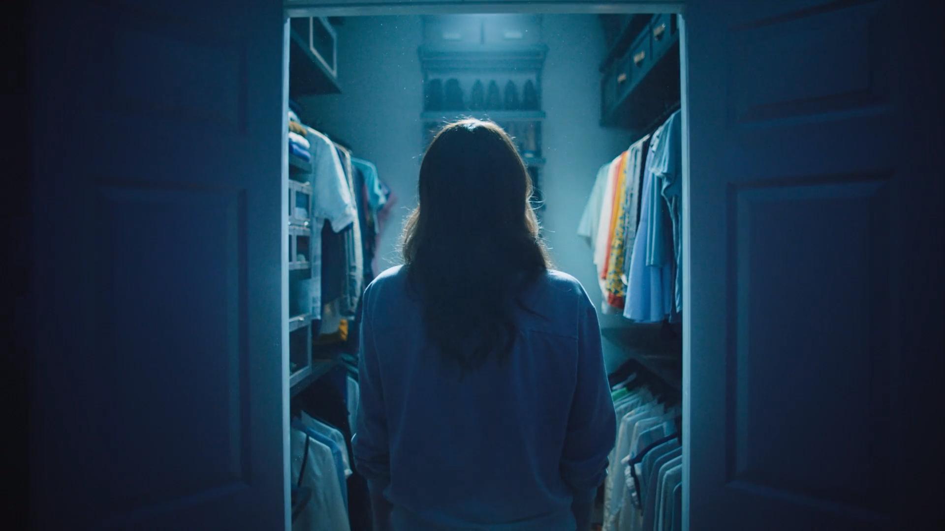 person clothing standing door woman text doorway dark